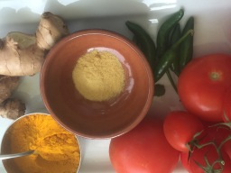 Ginger, turmeric, hing, green chillies and tomatoes