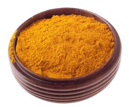 9728953 - curry powder, mix of indian spices on a vintage wooden bowl (isolated on white background)